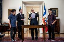 Photo sent by the president of Chile Sebastian Piñera with the ministry of justice and Human rights, Hernan Larrain and LGBTQ organization members Nov. 28, 2018 in Santiago (Chile). EPA-EFE/ Chile Government