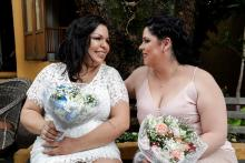 Gay businesswomen Michele Nobre (l.) and Stephanye dos Santos (r.) get married on Nov. 24, 2018, instead of waiting longer as they had planned, out of fear of a reduction of LGBT rights in Brazil following the inauguration of President-elect Jair Bolsonaro. EFE-EPA/Sebastiao Moreira