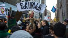 "Protests in New York City on April 14, 2016. One banner reads ""Fuck UR Wall"", denouncing Trump's policy on immigration. Photo: Wikimedia/Commons"