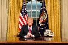 US President Donald J. Trump speaks to the nation in his first-prime address from the Oval Office of the White House in Washington, DC, USA, Jan. 8, 2019. EPA-EFE/CARLOS BARRIA / POOL