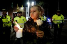 Citizens and police participate in a sit-in in front of the Francisco de Paula Santander police cadet academy in Bogota, Colombia, on Jan. 17, 2019, to honor the memory of those 20 cadets who died on Jan. 17, 2019, in a car-bomb attack. EPA-EFE/Leonardo Munoz