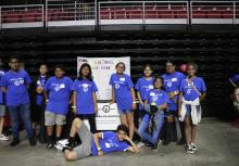 Sixth grade students from Eugenio Maria de Hostos Charter School pose in front of their project display in the Liacouras Center on May 30. Photo: Nigel Thompson/AL DÍA News.