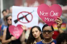 """Protester holding up an anti-gun violence sign that reads """"Not One More."""" Photo: Johannes Eisele/Getty Images"""
