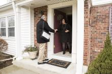 Census takers work in their community, going door-to-door interviewing residents who have not yet responded to the census. Photo: U.S. Census Bureau