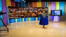"Bertha Acarapi during the news broadcast at ATB Television Studios in La Paz. Photo: Eduardo Leal, ""Cholita's Rise"""