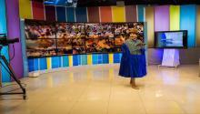 "Bertha Acarapiduring the news broadcast at ATB Television Studios in La Paz. Photo: Eduardo Leal, ""Cholita's Rise"""