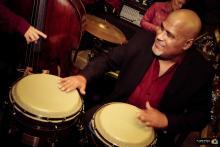 """Mr. Conga"" Noël Quintana smiles while playing the conga. Photo Courtesy of Noel Quintana's Latin Crew Facebook."