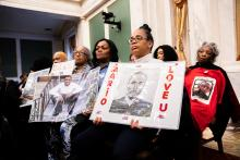 Attendees of a hearing for Philadelphia City Council's Special Committee on Gun Violence Prevention honor loved ones lost to gun violence in the city. Photo: Jared Piper/PHL Council