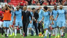 Manchester City manager Josep Guardiola (C-R) and Fernando (C-L) react after the English Premier League soccer match between Manchester United and Manchester City at Old Trafford, Manchester, Britain. EFE