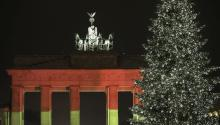 Brandenburg Gate in Berlin was lit up in the colours of the German flag to honour the truck attack victims. EFE/Joerg Carstensen