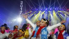 Performers gather and pose for photograph as they attend the count down event to celebrate the arrival 2017 new year during New Year's Eve celebration at Beijing Olympic Park in Beijing city, China, 01 January 2017. EFE/EPA/WU HONG