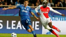 Juventus player Paulo Dybala (l) fights the ball with Monaco's Tiemoue Bakayoko (r) during a game for one of the UEFA Champions League semi-finals between Monaco and Juventus at the Luis II stadium of Monaco (Monaco). EFE