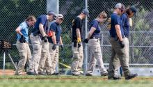 Members of an FBI Evidence Response Team work on the scene of a shootout at Eugene Simpson Stadium Park, in Alexandria, Virginia, United States. EFE