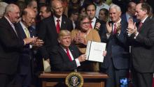US President Donald J. Trump shows the National Security Presidential Memorandum on Cuba, he signed after giving remarks at Manuel Artime Theater in Miami, Florida, USA. EFE