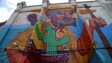 Es difícil dar un paseo por esta ciudad del estado de Baja California sin toparse con uno de los muchos murales y obras de grafiti que la adornan, y que ya se han convertido en una opción recurrente para varios espacios y edificios públicos. EFE/Alejandro Zepeda