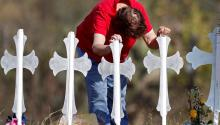 Maria Durand cries while visiting the 26 crosses installed in a field in Sutherland Springs, Texas, USA, on November 7, 2017, in honor of the 26 people who died in a shooting at a Baptist church.