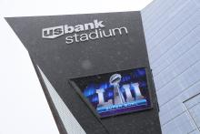 Snow falls in front of US Bank Stadium on the eve of Super Bowl LII at US Bank Stadium in Minneapolis, Minnesota, USA, on 03 February 2018.The NFC ChampionsPhiladelphiaEagleswill play the AFC Champions New England Patriots in the National Football League's annual championship game on 04 February. EFE