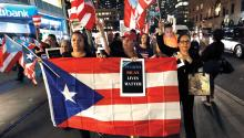 Hundreds of people protest near Trump Tower after a service for the victims of Hurricane Maria on Thursday, September 20, at the Church of St. Bartholomew in New York. EFE