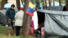 Venezuelan migrants seek shelter and remain in an improvised camp near a bus terminal in Bogota, Colombia. EFE