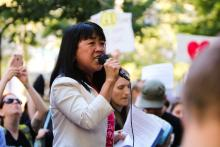 Philadelphia Councilwoman Helen Gym spoke at the June 19 rally in Rittenhouse Square against the Trump administration's immigration policies. Greta Anderson / AL DÍA News