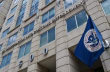 The Department of Homeland Security flag flies outside the Immigration and Customs Enforcement headquarters in Washington. (Olivier Douliery/AFP/Getty Images)