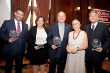 Five champions of the Latino community were awarded for their services at ALDIA's 1st Annual Latino History Luncheon. (From left to right) PA Secretary of Education, Pedro Rivera, Karla Hurley, President of Global Bilingual Solutions, the Honorable Nelson Diaz, Exec. Director of Norris Square Civic Association Patricia DeCarlo, and PA Secretary of State, Pedro Cortes. Photo: Peter Fitzpatrick/ALDIA News.