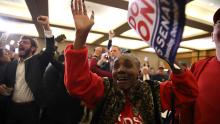 Supporters of Democrat Doug Jones celebrate as Jones is projected to be the winner in Alabama's special Senate election during his election night gathering Tuesday in Birmingham, Ala. Justin Sullivan/Getty Images