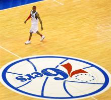 """Allen Iverson and the Sixers logo"" by Kevin Burkett - originally posted to Flickr as Allen Iverson and the Sixers. Licensed under CC BY-SA 2.0 via Commons."