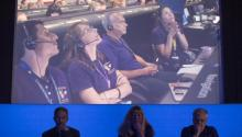 Earl Maize, Linda Spilker and Julie Webster, responsible for the Cassini spacecraft mission, see a video on the successful end of the probe mission in Pasadena, California (September 15, 2017). NASA / JOE KOWSKY