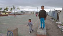 Children romp on only playground in Blikkiesdorp (Tin Can Town) a bleak relocation camp outside Cape Town composed to nearly 2,000 metal shacks arranged like a concentration camp. LBWPhoto