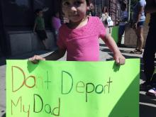 Darlin Mendoza's daughter protests his deportation outside of the ICE building in Philadelphia on Wednesday morning. Photo courtesy of the New Sanctuary Movement of Philadelphia.
