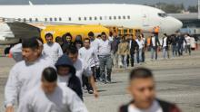 Immigrants deported from the United States arrive on an ICE deportation flight on February 9. Source: CNN.