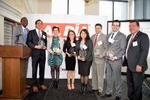 City Solicitor Sozi Tulante and AL DÍA Publisher and CEO Hernan Guaracao pose with awardees. From left to right: City Solicitor Sozi Tulante, Martin Arias, Ana Montalbaán, Lorena Trujillo, Caroline Cruz, Todd Rodriguez, Adriel Garcia, and AL DIA Publisher Hernán Guarcao