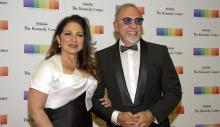 American singer-songwriter Gloria Estefan (L) and her husband, Emilio (R), arrive at the formal Artist's Dinner in honor of the winners of the 40th Kennedy Center Annual Awards sponsored by Secretary of State Rex Tillerson in the State Department of the United States in Washington, DC. December 2, 2017. EFE / EPA / RON SACHS