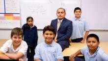 Roque Pech (center), a DACA beneficiary, poses with the sixth-graders from PUC Community Charter in Lakeview Terrace, California