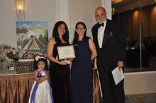 Maria Elisa Smith Gonzales (center) was one of three Latino students awarded a scholarship at the annual SILAMP Gala. (Photo courtesy of Luz Selenia Salas)