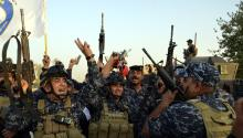 Iraqi Soldiers celebrate in the center of Mosul, Iraq, on Monday, July 10, 2017. Iraqi Prime Minister Haider al-Abadi declared Mosul's release from control of the self-proclaimed Islamic State (EI) group after eight months of clashes by Iraqi forces and a coalition led by the United States to overthrow the city's last militant stronghold. EFE/STR