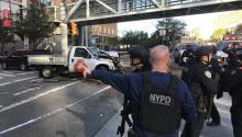 Members of the emergency unit remove the body of a fatal victim on Tuesday, October 31, 2017, after an incident where, according to the first reports, a man ran a truck over several people on a bike lane in downtown New York (United States). EFE / JASON SZENES
