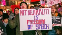 Demonstrators in front of Verizon stores on December 7, 2017. Photo: Sarah Tew/CNET