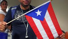 Vladimir Rivera holds a small Puerto Rico that he brought to the Press Conference on Thursday, September 21st, or Unidos PA' PR. Rivera is a native of Puerto Rico and has not been able to make contact with his family back home, including His mother, brother and daughter in San Juan. Photo: Matthew Haubenstein