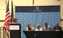 Rosie Perez moderating the Puerto Rico Panel at the DNC Hispanic Caucus