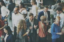 A diverse group of business professionals gather at a meet and greet. Photo courtesy: ThinkStock
