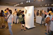"""Guests celebrate the opening of the studio glass exhibition """"Transparency: An LGBTQ+ Glass Art Exhibition"""" at the National Liberty Museum this past weekend. Photo: Peter Fitzpatrick/AL DIA News"""