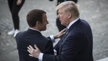 US President Donald J. Trump talks to his French counterpart, Emmanuel Macron, while attending the Bastille Day Parade on the Champs Elysees in Paris on July 14, 2017 EFE/Ian Langsdon