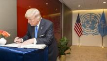 Photo courtesy of the UN, where the US President Donald Trump is signing the United Nations guest book on Tuesday, September 19, 2017, after a meeting with its secretary general at the agency's headquarters in New York. EFE / Rick Bajornas / UN