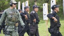 U.S. Border Patrol Agent supervises Guatemalan police officers with the Interagency Task Force Tecun Uman, during 9 mm weapons training in Guatemala, June 12, 2013. The U.S. Army worked with U.S. Border Patrol to train the newly formed Guatemalan Task Force with the mission of interdicting the flow of illicit activities on the Guatemalan borders. Source: Wikimedia