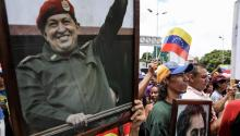 Chavistas participate in a demonstration with a picture of the late President Hugo Chávez (1999-2013) and El Libertador, Simón Bolívar, to support the installation of the National Constituent Assembly on Friday, August 4, 2017, in Caracas, Venezuela.