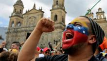A Venezuelan resident in Colombia shouts during the popular consultation on July 16, 2017, in Bogotá (Colombia). Thousands of Venezuelans voted Sunday in the popular consultation promoted by the opposition of Venezuela to consult the citizens if they are for or against the Constituent Assembly proposed by the Government of Nicolás Maduro. EFE/LEONARDO MUÑOZ