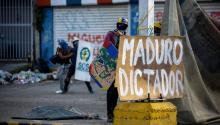 Opposition protesters face agents of the Bolivarian National Guard while blocking a street in rejection of the National Constituent Assembly elections onSunday, July 30, 2017, in Caracas, Venezuela.EFE/CRISTIAN HERNÁNDEZ