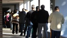 Voters must endure long lines at the polls, but in just days they have made history. Photo: DallasNews